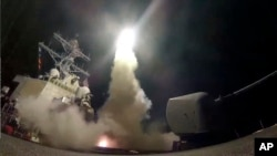 The U.S. Navy guided-missile destroyer USS Porter launches a Tomahawk missile in the Mediterranean Sea, April 7, 2017. The United States blasted a Syrian airfield with a barrage of cruise missiles in fiery retaliation for this week's chemical weapons att