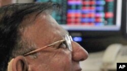 An Indian stock broker reacts while looking at Sensex stock index at brokerage firm in Mumbai, India, 13 Sep 2010