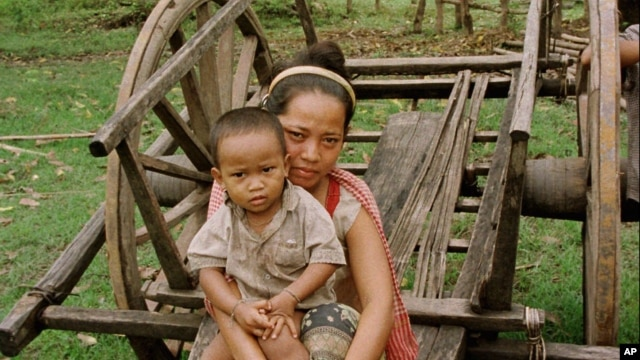 A mother and child of the Phnong tribal group rest after scouring for food in Kampong Pneu, a remote, poor region of northeastern Cambodia.