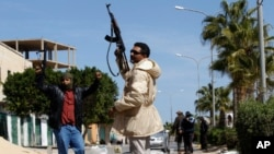 Gunmen opposed to leader Moammar Gadhafi holding their weapons are seen in the center of the city of Zawiyah, 50 km west of the capital Tripoli, March 5, 2011