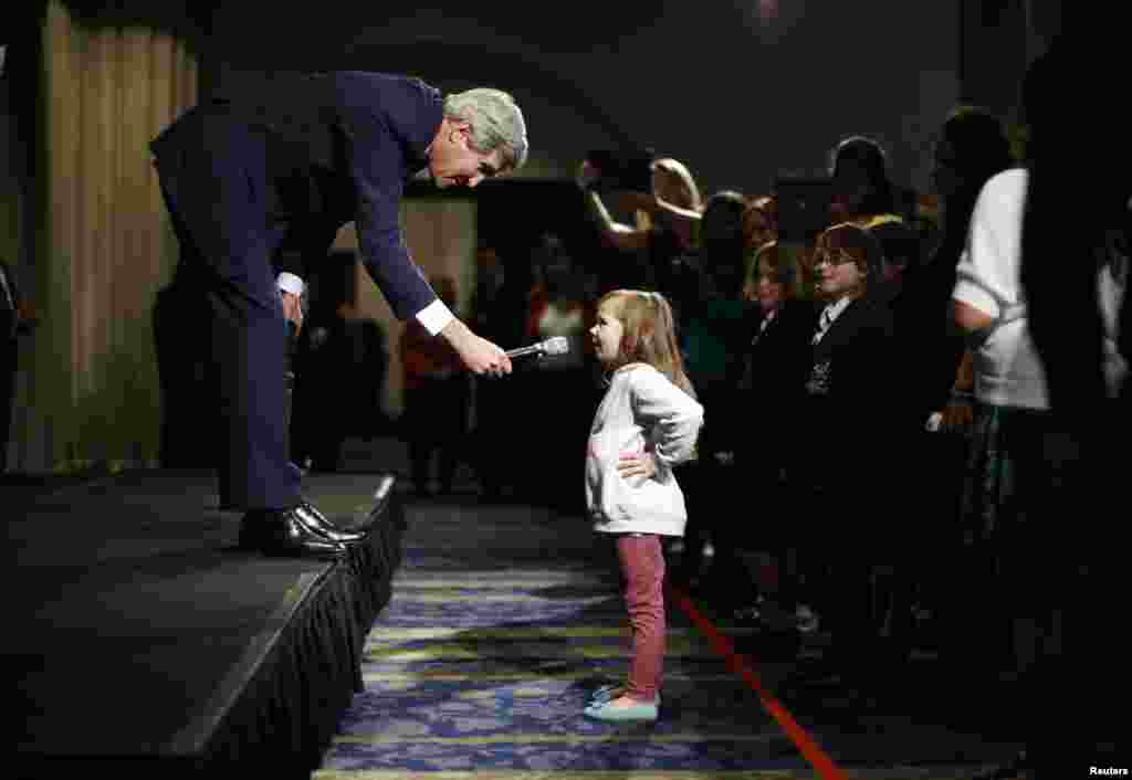 U.S. Secretary of State John Kerry speaks with five-year-old Dara Edwards, the daughter of an American staffer at the U.S. Consulate in Sydney, Australia, as he meets embassy and consular staff.