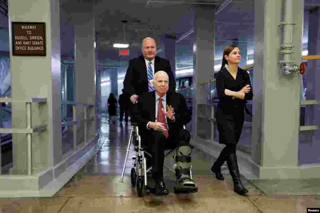 Sen. John McCain heads to the Senate floor ahead of votes on Capitol Hill in Washington, Dec. 6, 2017.