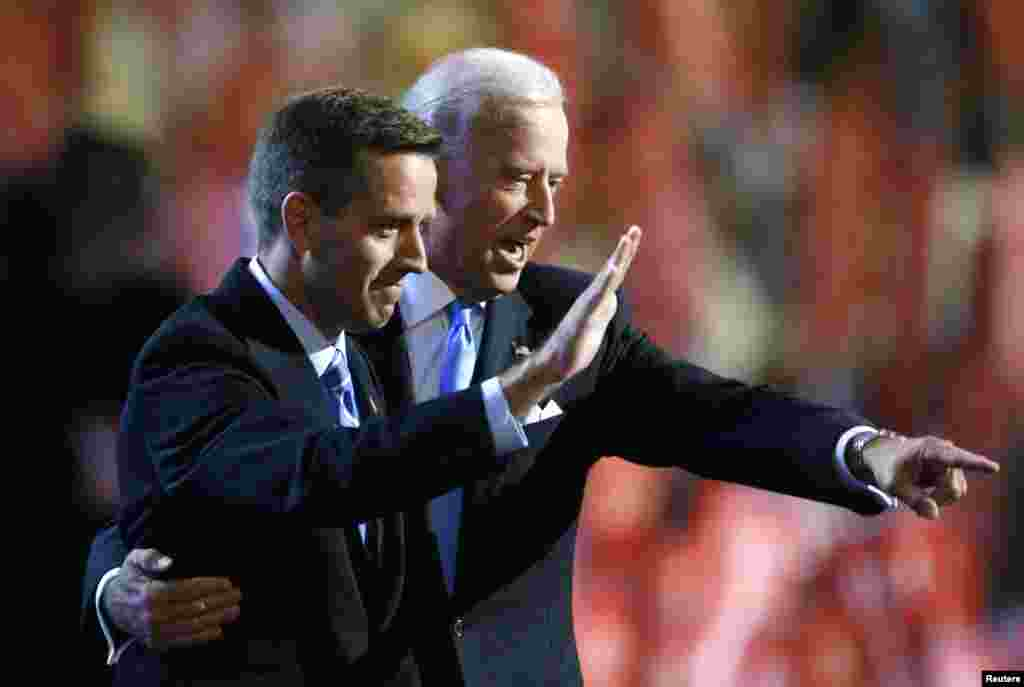 Attorney General Beau Biden (D-DE) and his father, vice presidential candidate Senator Joe Biden (D-DE) gesture on stage at the 2008 Democratic National Convention in Denver, Colorado, August 27, 2008.