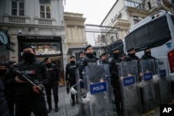 FILE - Riot police stand outside the Netherlands consulate as the supporters of Turkey's President Recep Tayyip Erdogan stage a protest in Istanbul, March 11, 2017.