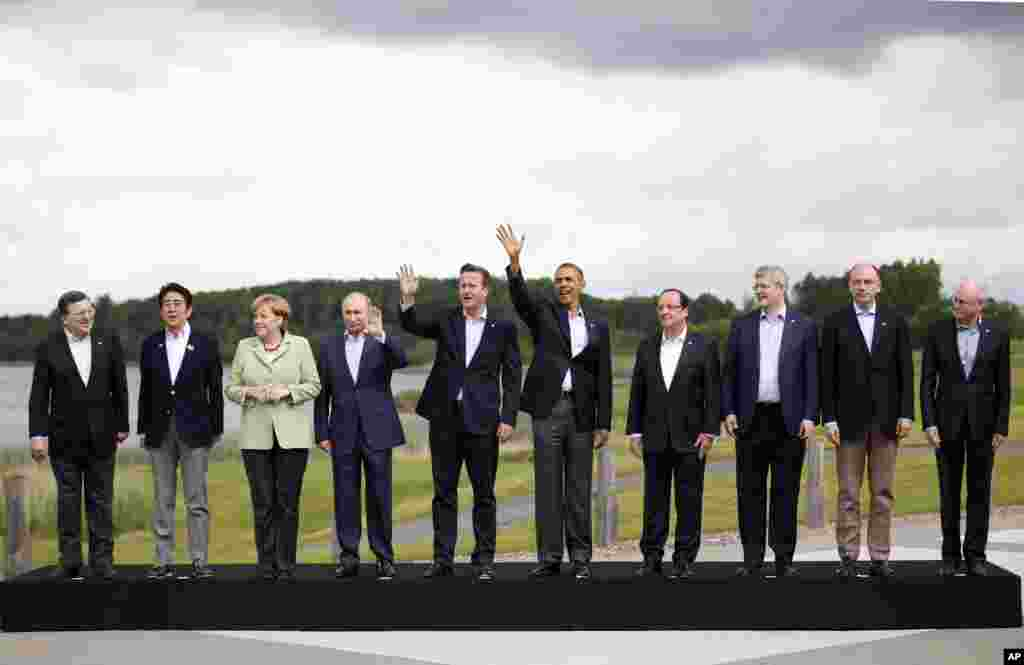 G8 leaders pose for a group photo at the G8 summit at the Lough Erne golf resort in Enniskillen, Northern Ireland, June 18, 2013.