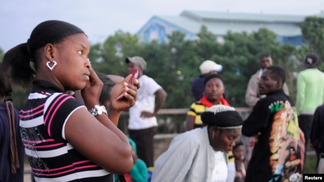 FILE - Haitian residents, who have been living and working undocumented in the Dominican Republic wait for Dominican immigration officials to allow them back, at a border post in Ouanaminthe, January 10, 2013.