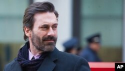 """Jon Hamm helps unveil a """"Mad Men"""" bench in front of the Time & Life Building, March 23, 2015 in New York."""
