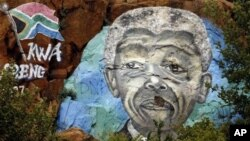 Mural depicting former South African President Nelson Mandela in Soweto, Dec. 12, 2012.