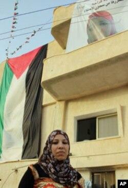 Samud Kraja outside her family home in the village of Saffa near Ramallah.