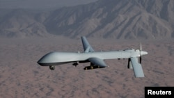 FILE - An undated handout photo courtesy of the U.S. Air Force shows an unmanned MQ-1 Predator drone.