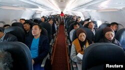 FILE - Passengers are seen during a flight of VietJet Air from Hanoi to Ho Chi Minh city, Vietnam, Jan. 12, 2018.