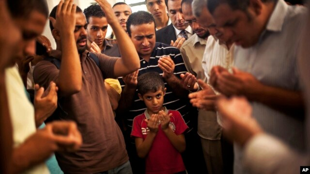 Son of the late Ammar Badie prays during his father's funeral in al-Hamed mosque in Cairo's Katameya district on Aug. 18, 2013. Badie, the son of Muslim Brotherhood's spiritual leader Mohammed Badie, was killed by Egyptian security forces Friday.