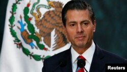 Mexico's President Enrique Pena Nieto gives a speech at the National Palace in Mexico City, Nov. 21 2017.