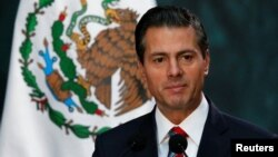 FILE - Mexico's President Enrique Pena Nieto gives a speech at the National Palace in Mexico City, Nov. 21 2017.