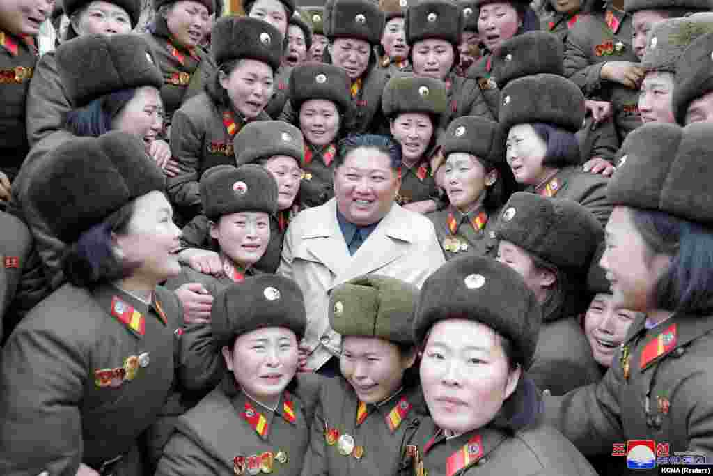 North Korean leader Kim Jong Un inspects a women company belonging to 5492 troops, in this undated picture released by North Korea's Central News Agency (KCNA).