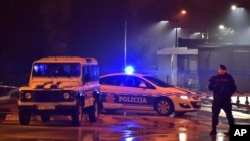 Police block off the area around the U.S. Embassy in Montenegro's capital Podgorica, Feb. 22, 2018. Local media say that an unknown assailant hurled a hand grenade toward the embassy around midnight local time (1100 GMT) and then killed himself with anoth