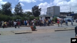 Ethiopians line up at a government-operated stand in Addis Ababa to purchase cooking oil and sugar, April 13, 2011