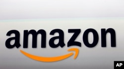 FILE - Amazon is making another move toward more brick and mortar outlets,
