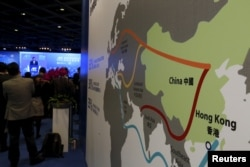 "FILE - A map illustrating China's silk road economic belt and the 21st-century maritime silk road, or the ""Belt and Road"" megaproject, is displayed at the Asian Financial Forum in Hong Kong, China Jan. 18, 2016."