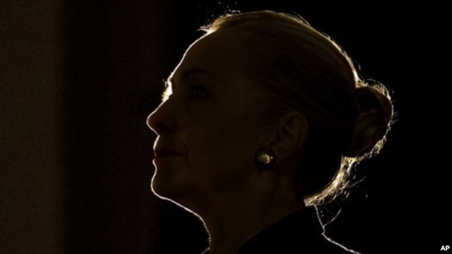 U.S. Secretary of State Hillary Clinton silhouetted by stage light, University of the Western Cape, South African, Aug. 8, 2012.