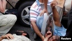 7月5日在开罗,在支持穆尔西的示威中受伤的人。
