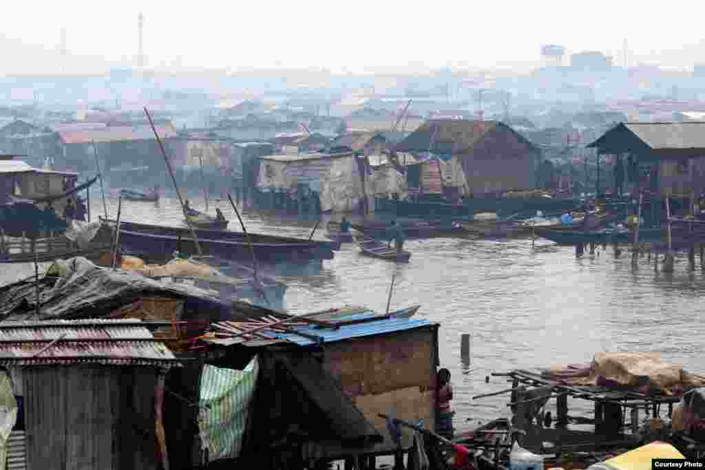 The government calls this sprawling village in the lagoon a shantytown, but residents say Makoko is not just a place, it is a way of life in Makoko, Lagos, July 5, 2013. Photo:  VOA/H. Murdock
