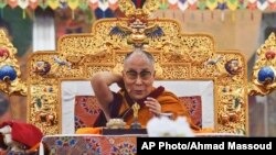 Tibetan spiritual leader the Dalai Lama addresses devotees on the first day of Kalachakra in Bodhgaya, India, Jan. 2, 2017.