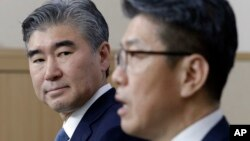 U.S. State Department's Special Representative for North Korea Policy Sung Kim, left, watches as his South Korean counterpart Kim Hong-kyun speaks during a joint press conference after their meeting to exchange views on North Korea's fifth nuclear test conducted on last Friday at the Foreign Ministry in Seoul, South Korea, Tuesday, Sept. 13, 2016.
