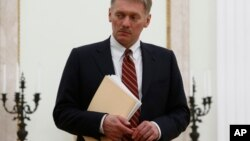 FILE - Russian President Vladimir Putin's spokesman Dmitry Peskov is seen at the Kremlin in Moscow, Russia, March 27, 2017.