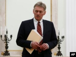 FILE - Kremlin spokesman Dmitry Peskov is seen at the Kremlin in Moscow, March 27, 2017. Peskov likened a report detailing the wealth and political activities of Kremlin insiders and billionaires to a U.S. enemies list.