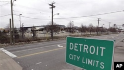 A street sign showing Detroit's city limits is shown near where a former Chrysler McGraw glass plant is being torn down along Ford Road in Detroit, March 22, 2011