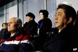 Kim Yong Nam, top left, president of the Presidium of North Korean Parliament, and Kim Yo Jong, sister of North Korean leader Kim Jong Un, top right, sit behind U.S. Vice President Mike Pence, bottom left, and Japanese Prime Minister Shinzo Abe
