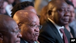 President Jacob Zuma (C) and deputy president Cyril Ramaphosa (R) attend the declaration announcement of the municipal elections in Pretoria, South Africa, Aug. 6, 2016. This is the worst-ever election showing for South Africa's ruling party.