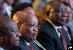 FILE - President Jacob Zuma (C) and deputy president Cyril Ramaphosa (R) attend the declaration announcement of the municipal elections in Pretoria, South Africa, Aug. 6, 2016.