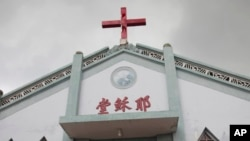 """FILE - In this photo taken July 15, 2014, the Wuxi Christian Church with the words """"Church of Jesus"""" in red in is seen in Longwan, Wenzhou, in eastern China's Zhejiang province."""