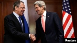 U.S. Secretary of State John Kerry (R) shakes hands with Russian Foreign Minister Sergey Lavrov at the start of their meeting in Berlin, February 26, 2013.
