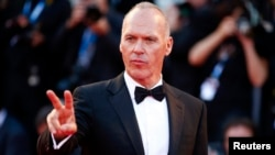 "FILE - Actor Michael Keaton, who received a Golden Globe nomination for Best Actor in a Comedy or Musical for his role in ""Birdman,"" appears at the 71st Venice Film Festival, Aug. 27, 2014."