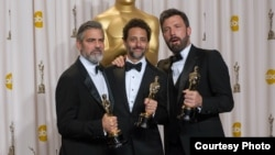 "Producers George Clooney, Grant Heslov and Ben Affleck pose for the press after winning the Oscar® for best motion picture of the year for ""Argo"", Feb. 24, 2013. (Photo: AMPAS)"