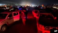 Afghan military and officials leave Kandahar city during fighting between the Taliban and Afghan security personnel, in Kandahar, southwest of Kabul, Afghanistan, Thursday, Aug. 12, 2021. (AP Photo/Sidiqullah Khan)