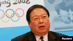 FILE - Hong Kong's Secretary for Home Affairs Patrick Ho speaks during a news conference, announcing that the equestrian events at the 2008 Beijing Olympics would be staged in Hong Kong, July 8, 2005, .