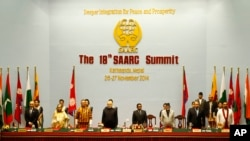 FILE - South Asian leaders stand during the 18th summit of the South Asian Association for Regional Cooperation (SAARC) in Katmandu, Nepal, Nov. 26, 2014.