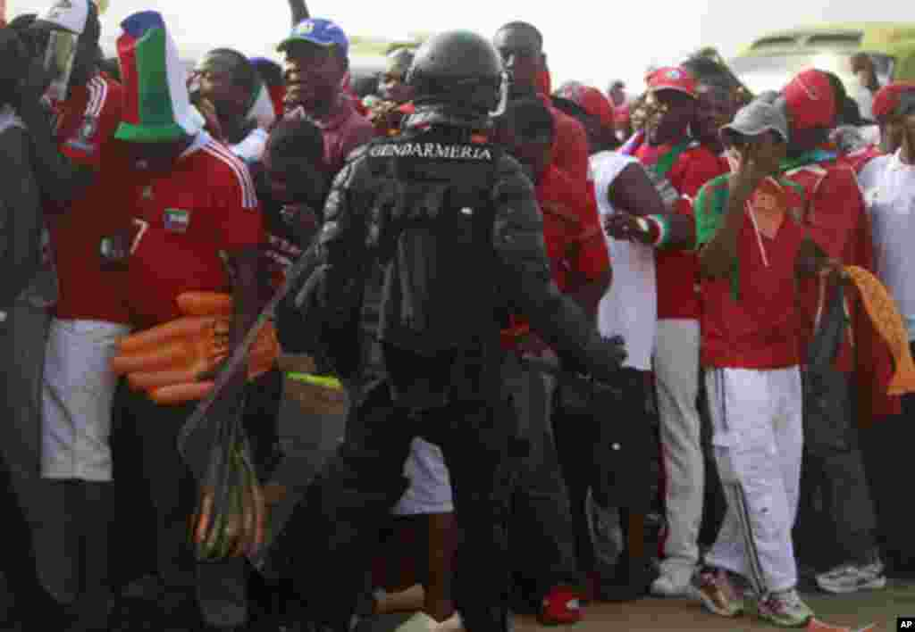 """Equatorial Guinea's special police forces try to control Equatorial Guinea fans inside Estadio de Bata """"Bata Stadium"""", which will host the opening match and ceremony for the African Nations Cup, in Bata January 21, 2012. Picture taken January 21, 2012. RE"""