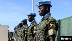 Ugandan peacekeeping troops stand during a ceremony at Mogadishu airport in Somalia May 18, 2014. U.N.-backed peacekeepers pushed the Islamist fighters out of Mogadishu in 2011, but the al Qaida-linked group has continued to launch guerrilla-style attacks.