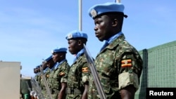 Ugandan peacekeeping troops stand during a ceremony at Mogadishu airport in Somalia May 18, 2014.