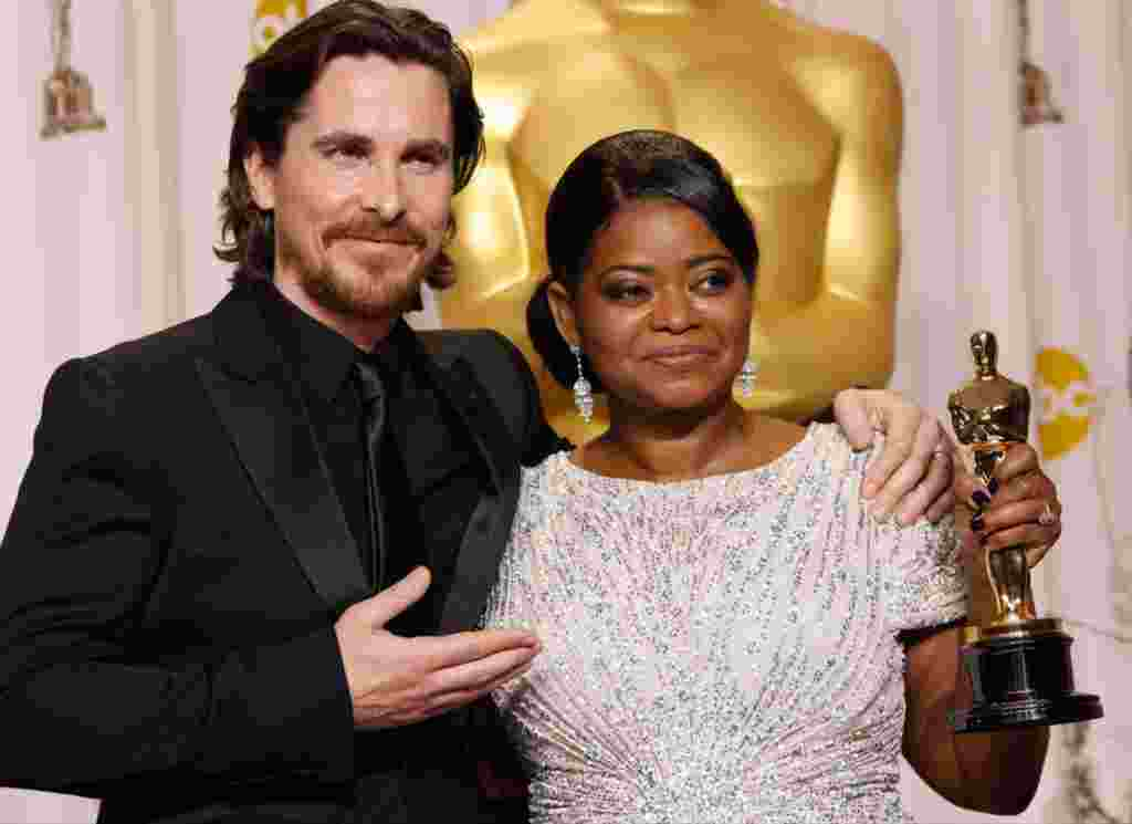 "Octavia Spencer with presenter Christian Bale and her award for best supporting actress in ""The Help."" (AP)"