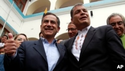 Ecuador President Rafael Correa, right, accompanies Augusto Barrera, left, of the ruling PAIS Alliance party and candidate for re-election as mayor of Quito after Barrera voted in local elections in Quito, Feb. 23, 2014.