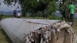 調查人員研判一片殘骸是否屬於馬航失蹤客機