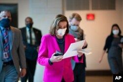 FILE - Speaker of the House Nancy Pelosi, D-Calif., walks to a news conference as the Democratic-led House prepares to pass a bill extending protections for LGBTQ people, Feb. 25, 2021.
