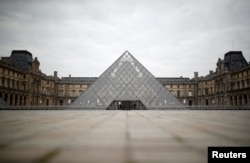 A view shows the deserted area in front of the glass Pyramid of the Louvre museum in Paris as a lockdown is imposed to slow the rate of the coronavirus disease (COVID-19) in France, March 18, 2020.