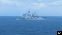 FILE - This undated file photo released on Tuesday, Sept. 15, 2020, by Indonesian Maritime Security Agency (BAKAMLA) shows a Chinese Cost Guard ship sails in North Natuna Sea. Earlier this month, an Indonesian patrol ship confronted a Chinese coast…